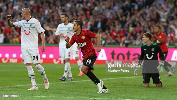 """Javier """"Chicharito"""" Hernandez of Manchester United celebrates scoring their first goal during the pre-season friendly match between Hannover 96 and..."""
