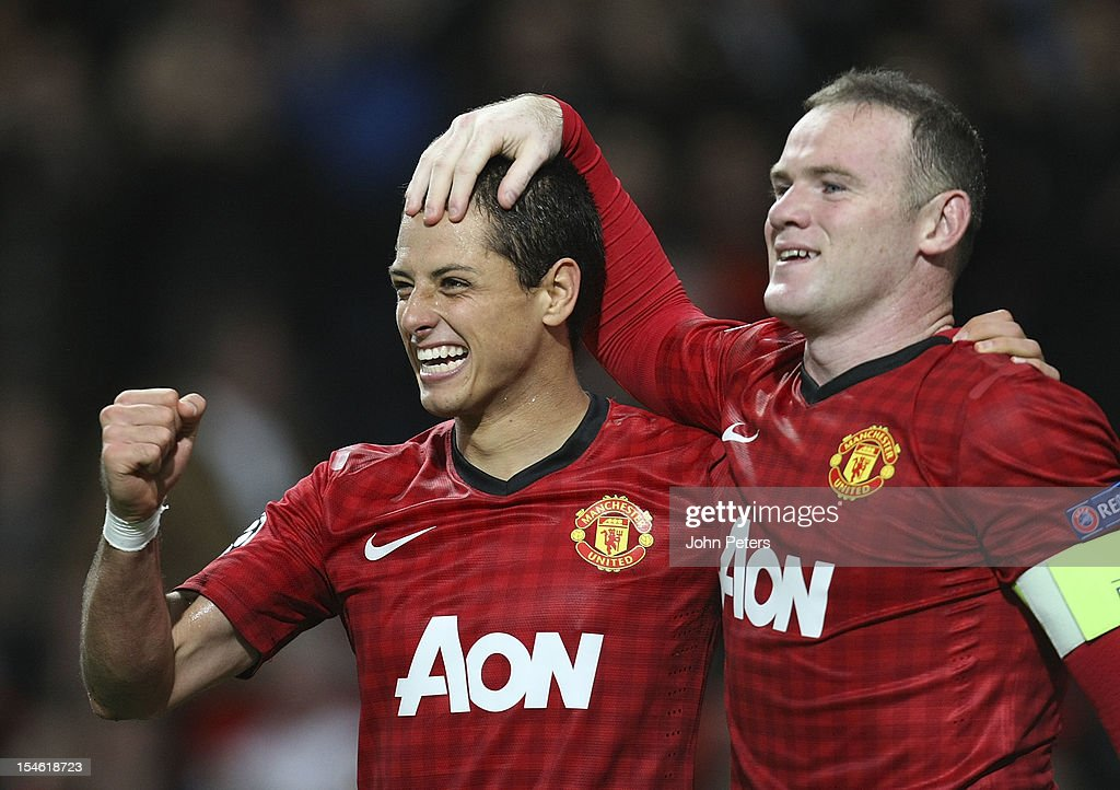Javier 'Chicharito' Hernandez (L) of Manchester United celebrates scoring their third goal during the UEFA Champions League Group H match between Manchester United and SC Braga at Old Trafford on October 23, 2012 in Manchester, England.