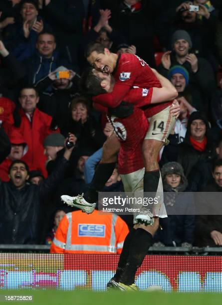 Javier 'Chicharito' Hernandez of Manchester United celebrates scoring their fourth goal during the Barclays Premier League match between Manchester...