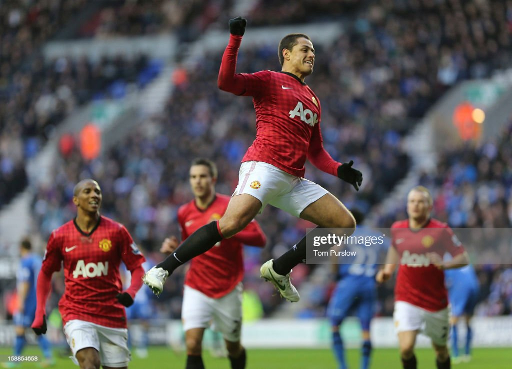 Javier 'Chicharito' Hernandez of Manchester United celebrates scoring their first goal during the Barclays Premier League match between Wigan Athletic and Manchester United at DW Stadium on January 1, 2013 in Wigan, England.