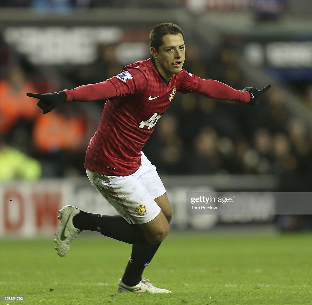 Javier 'Chicharito' Hernandez of Manchester United celebrates scoring their third goal during the Barclays Premier League match between Wigan Athletic and Manchester United at DW Stadium on January 1, 2013 in Wigan, England.