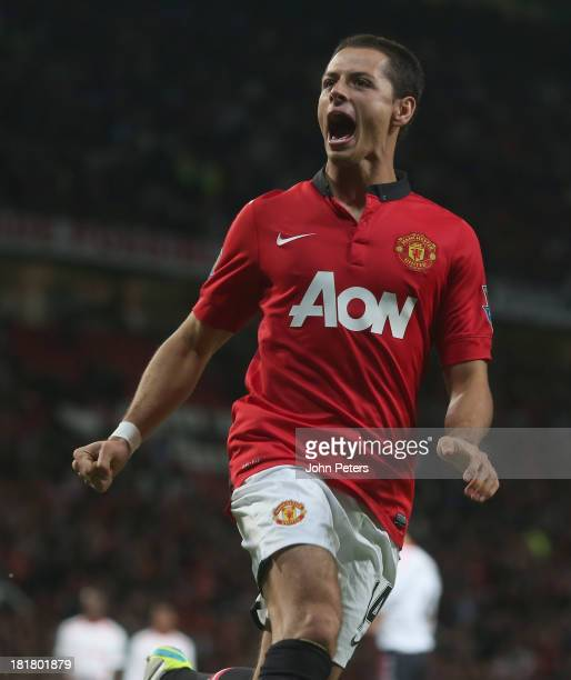 Javier 'Chicharito' Hernandez of Manchester United celebrates scoring their first goal during the Capital Cup Third Round match between Manchester...