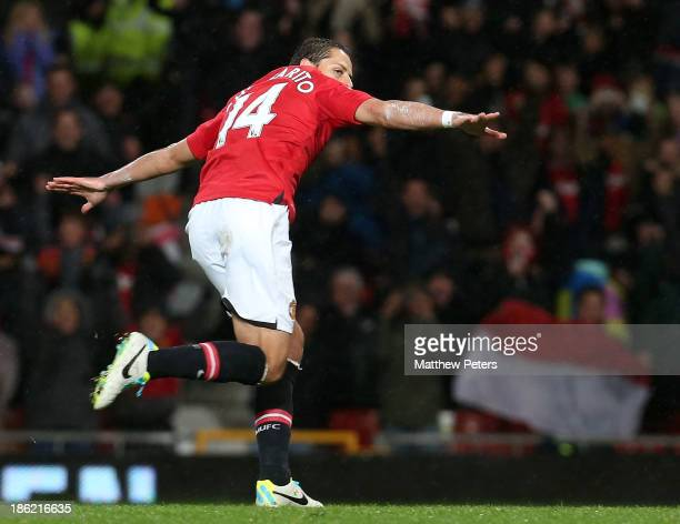 "Javier ""Chicharito"" Hernandez of Manchester United celebrates scoring their first goal during the Capital One Cup Fourth Round match between..."