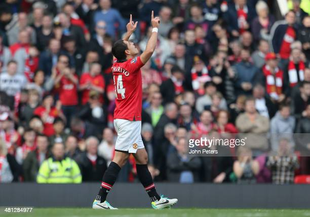 Javier Chicharito Hernandez of Manchester United celebrates scoring their fourth goal during the Barclays Premier League match between Manchester...