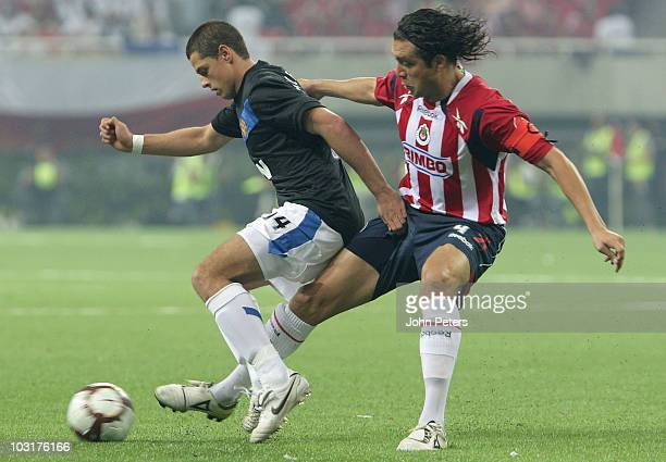 Javier Chicharito Hernandez of Manchester United clashes with Hector Reynoso Lopez of Chivas Guadalajara during the preseason friendly match between...