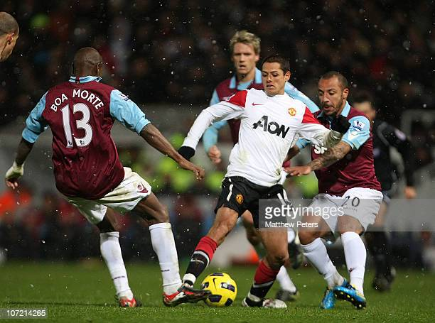 """Javier """"Chicharito"""" Hernandez of Manchester United clashes with Luis Boa Morte and Julien Faubert of West Ham United during the Carling Cup..."""