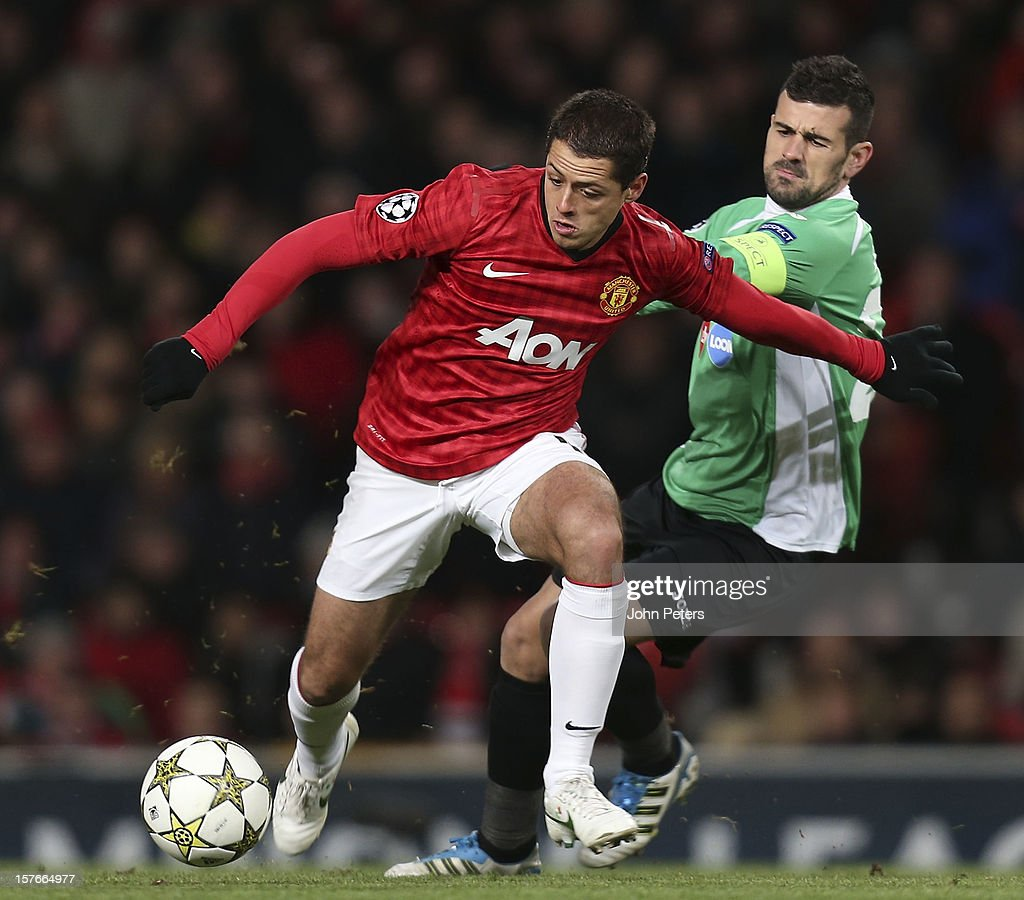 Javier 'Chicharito' Hernandez of Manchester United in action with Cadu of CFR 1907 Cluj during the UEFA Champions League Group H match between Manchester United and CFR 1907 Cluj at Old Trafford on December 5, 2012 in Manchester, England.