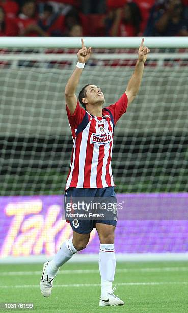 Javier Chicharito Hernandez of Manchester United playing for his old team of Chivas Guadalajara in the first half celebrates scoring Chivas' first...