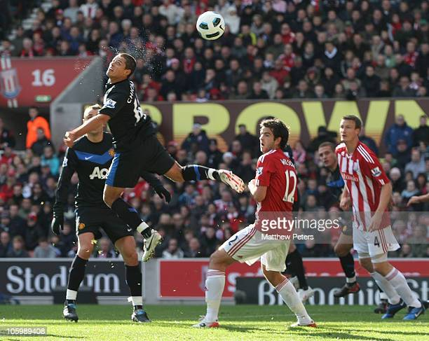 Javier 'Chicharito' Hernandez of Manchester United scores their first goal during the Barclays Premier League match between Stoke City and Manchester...