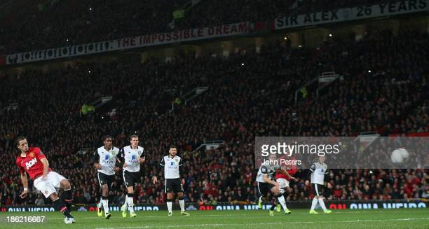 "Javier ""Chicharito"" Hernandez of Manchester United scores their first goal during the Capital One Cup Fourth Round match between Manchester United..."