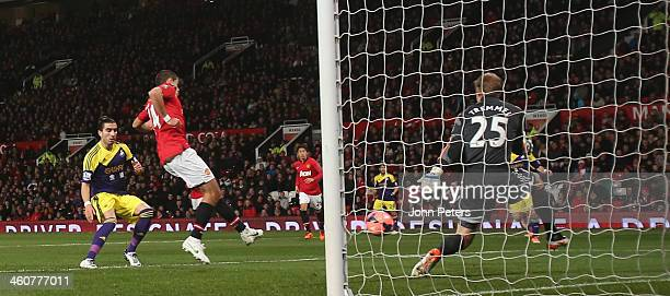 Javier 'Chicharito' Hernandez of Manchester United scores their first goal during the FA Cup Third Round match between Manchester United and Swansea...