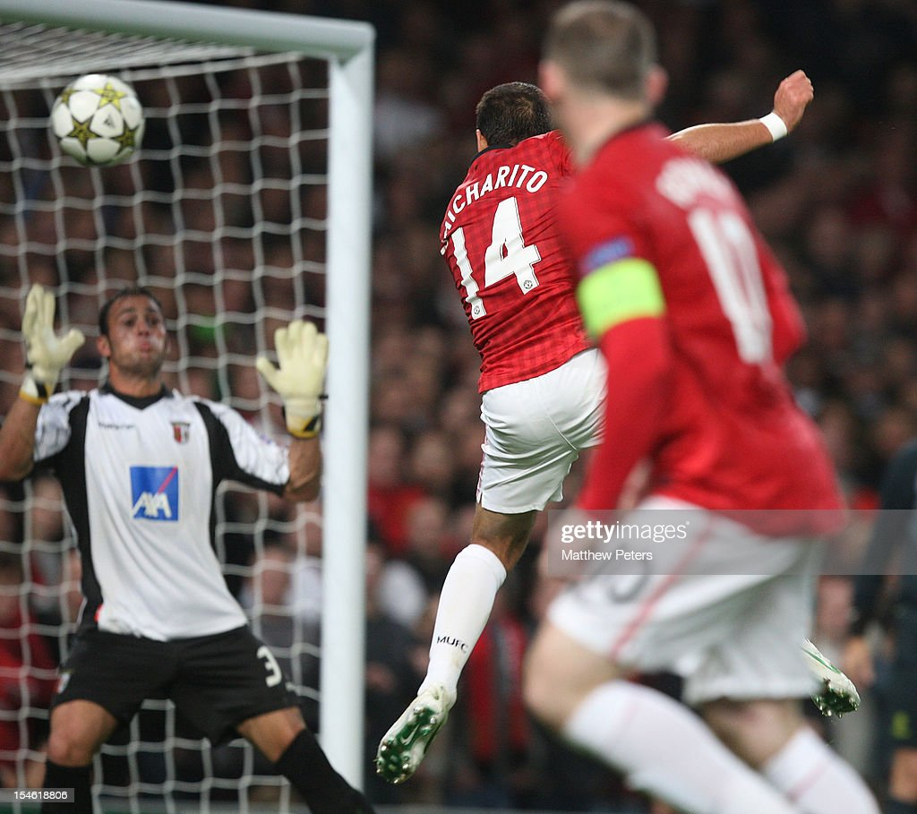 Javier 'Chicharito' Hernandez (L) of Manchester United scores their third goal during the UEFA Champions League Group H match between Manchester United and SC Braga at Old Trafford on October 23, 2012 in Manchester, England.