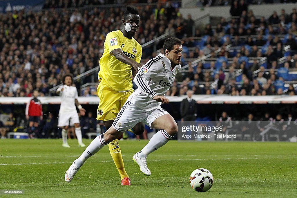 Javier 'Chicharito' Hernandez of Real Madrid competes for the ball with Eric Bailly of Villarreal during the La Liga match between Real Madrid CF and Villarreal CF at Estadio Santiago Bernabeu on March 1, 2015 in Madrid, Spain.