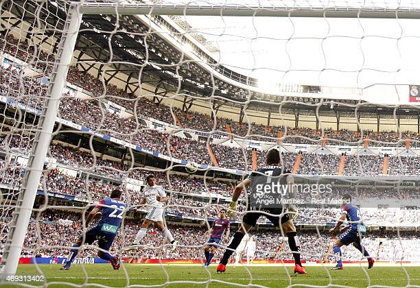 Javier 'Chicharito' Hernandez of Real Madrid heads the ball to score his team's second goal during the La Liga match between Real Madrid CF and Eibar...