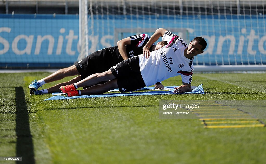 Javier 'Chicharito' Hernandez of Real Madrid stretches during a training session at Valdebebas training ground on September 2, 2014 in Madrid, Spain.