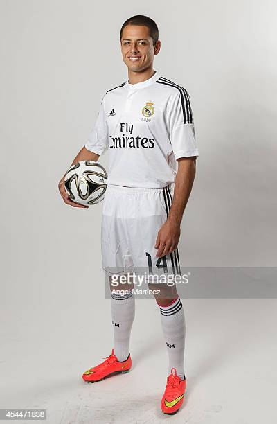 Javier 'Chicharito' Hernandez poses during his official unveiling as a new Real Madrid player at Estadio Santiago Bernabeu on September 1 2014 in...