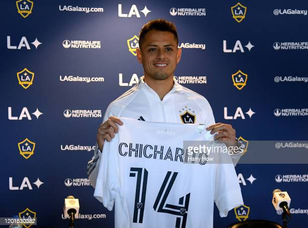 Javier Chicharito Hernandez poses with his jersey during a press conference at Dignity Health Sports Park on January 23 2020 in Carson California