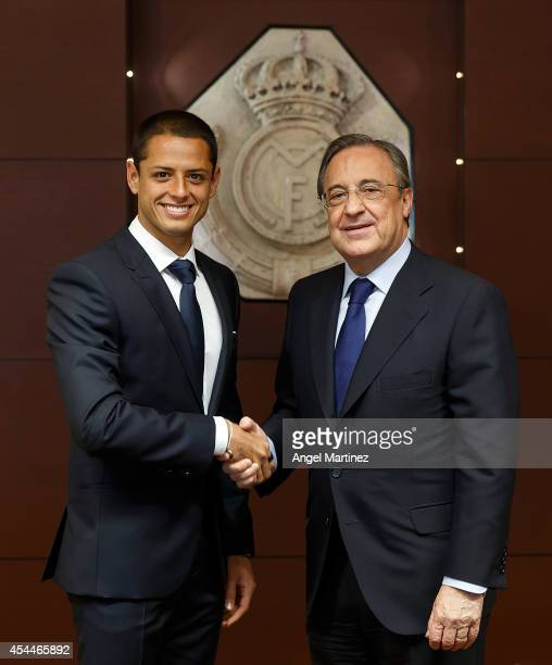 Javier 'Chicharito' Hernandez shakes hands with Real Madrid president Florentino Perez during his official unveiling as a new Real Madrid player at...