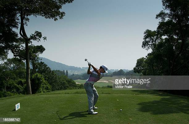 Javier Colomo of Spain tees off on the 5th hole during day four of the Venetian Macau Open at Macau Golf and Country Club on October 20 2013 in Macau...