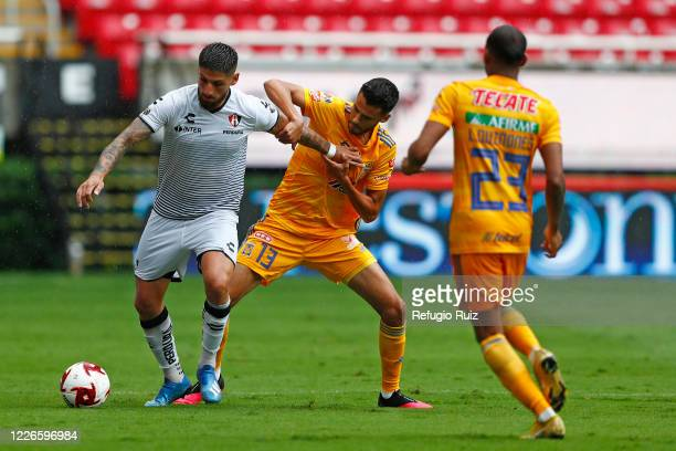 Javier Correa of Atlas fights for the ball with Diego Reyes of Tigres during the match between Atlas and Tigres UANL as part of the friendship...