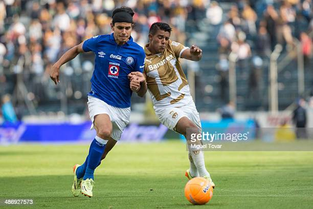 Javier Cortes of Pumas fights for the ball with Gerardo Flores of Cruz Azul during a match between Cruz Azul and Pumas UNAM as part of the 17th round...