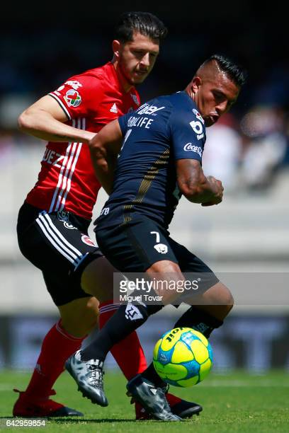 Javier Cortes of Pumas fights for the ball with Guido Rodriguez of Xolos during the 7th round match between Pumas UNAM and Tijuana as part of the...