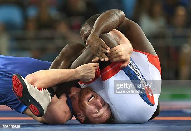 Javier Cortina Lacerra of Cuba and Albert Saritov of Romania compete in the Men's Freestyle 97kg Repechage round 2 match on Day 16 of the Rio 2016...