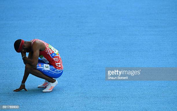 Javier Culson of Puerto Rico reacts after being disqualified in the Men's 400m Hurdles Final on Day 13 of the Rio 2016 Olympic Games at the Olympic...