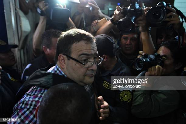 Javier Duarte, former governor of the Mexican state of Veracruz is escorted by police for a hearing at the Supreme Court in Guatemala City on April...