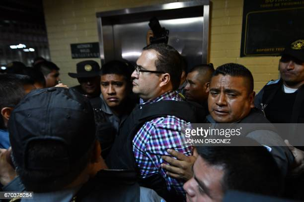 Javier Duarte , former governor of the Mexican state of Veracruz, leaves the court under escort after a hearing at the Supreme Court in Guatemala...