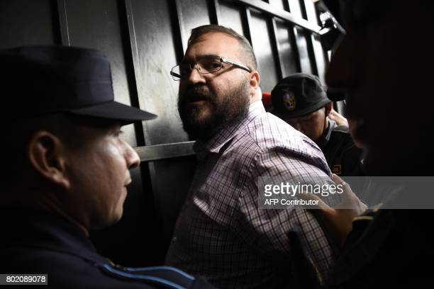 Javier Duarte, former governor of the Mexican state of Veracruz, accused of graft and involvement in organized crime, is escorted by police officers...