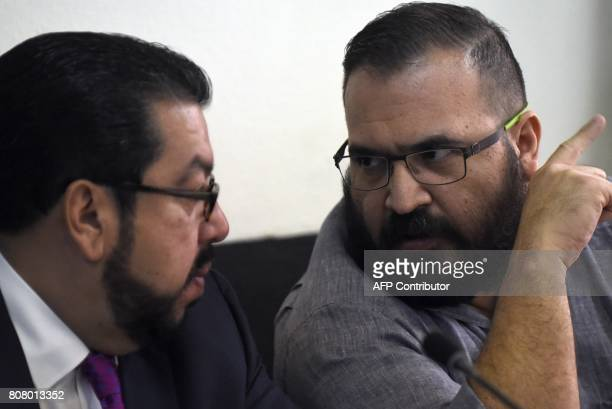 Javier Duarte former governor of the Mexican state of Veracruz accused of graft and involvement in organized crime speaks with his lawyer Carlos...