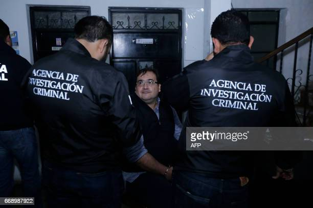 Javier Duarte, the former governor of the Mexican state of Veracruz, sits handcuffed following his arrest in Panajache municipality, Solola...