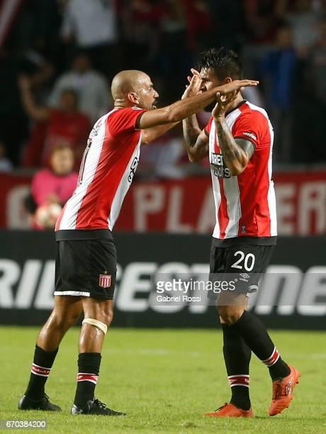 Javier Fabian Toledo of Estudiantes celebrates with teammate Juan Sebastian Veron after scoring during a group stage match between Estudiantes and...