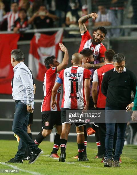 Javier Fabian Toledo of Estudiantes celebrates with teammates after socring the opening goal during a group stage match between Estudiantes and...