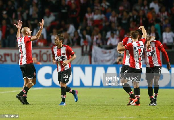 Javier Fabian Toledo of Estudiantes celebrates with teammates after scoring the opening goal during a group stage match between Estudiantes and...