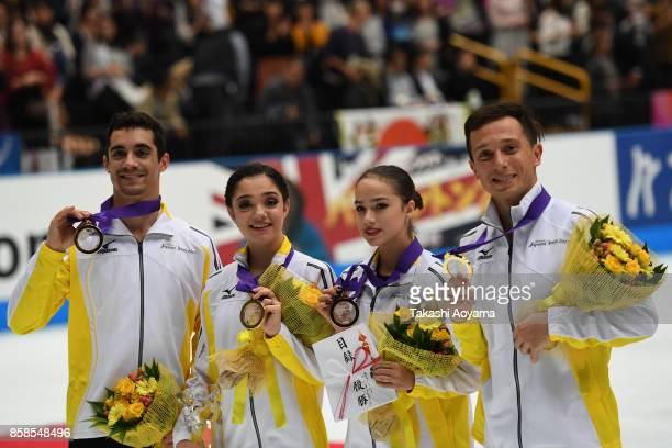 Javier Fernandez Evgenia Medvedeva Alina Zagitova and Alexei Bychenko of team Europe pose with their medals during the figure skating Japan Open at...