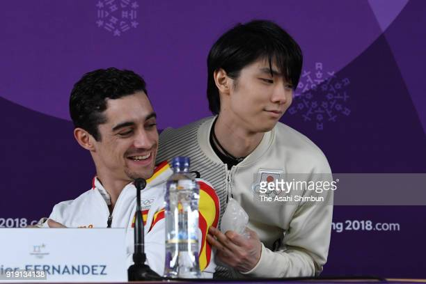 Javier Fernandez of Spain and Yuzuru Hanyu of Japan attend a press conference after competing in the Men's Single Skating Short Program on day seven...