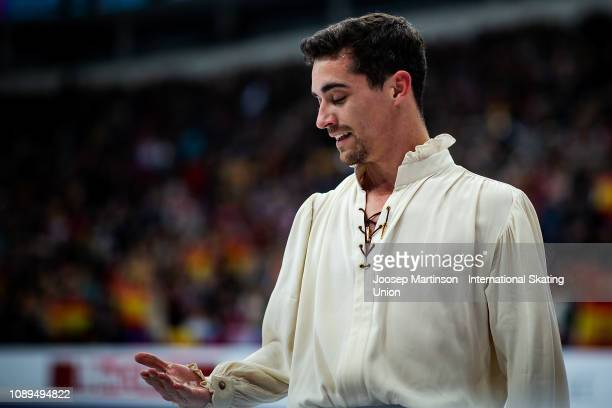 Javier Fernandez of Spain looks at ice in his hand after competing in his last competition in the Men's Free Skating during day four of the ISU...