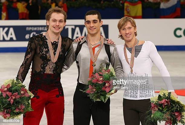 Javier Fernandez of Spain wins the gold medal in front of silver medal Sergei Voronov of Russia and Konstantin Menshov of Russia in the Men Skating...