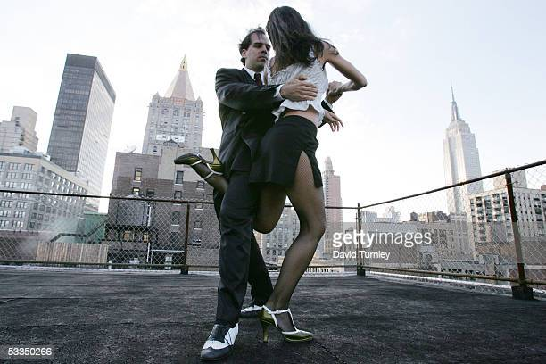 Javier Garcia and Moira Sauvane dance the tango on a Manhattan rooftop June 17, 2005 in New York City. Javier Garcia, an Argentinian-American and a...