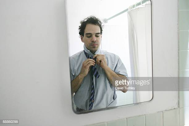 Javier Garcia gets dressed in his apartment before going to work as a psychiatric resident at Long Island Jewish Hospital June 14, 2005 in New Hyde...