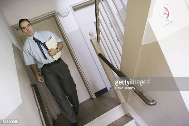 Javier Garcia leaves his apartment for work as a psychiatric resident at Long Island Jewish Hospital June 14, 2005 in New Hyde Park, New York. Javier...