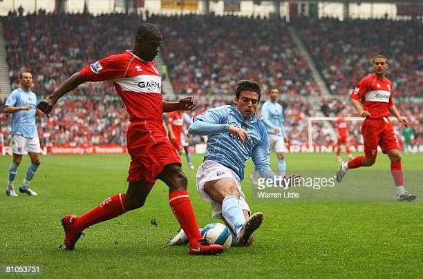 Javier Garrido of Manchester City tackles George Boateng of Middlesbrough during the Barclays Premier League Match between Middlesbrough and...