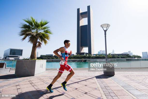 Javier Gomez of Spain competes during the run leg of IRONMAN 703 Middle East Championship Bahrain on November 25 2017 in Bahrain Bahrain