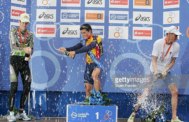 Javier Gomez of Spain has champagne emptied over him by Sven Riederer of Switzerland and Brad Kahlefeldt of Australia after the Mens World Cup at the...