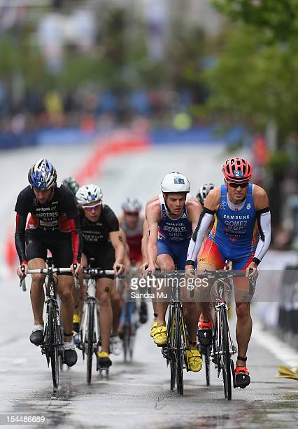 Javier Gomez of Spain Jonathan Brownlee of Great Britain and Sven Riederer of Switzerland compete in the cycle leg during the 2012 ITU World...