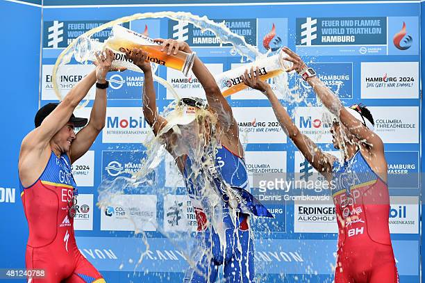Javier Gomez of Spain Vincent Luis of France and Mario Mola of Spain celebrate after the Men's Elite Sprint race during the ITU World Triathlon...