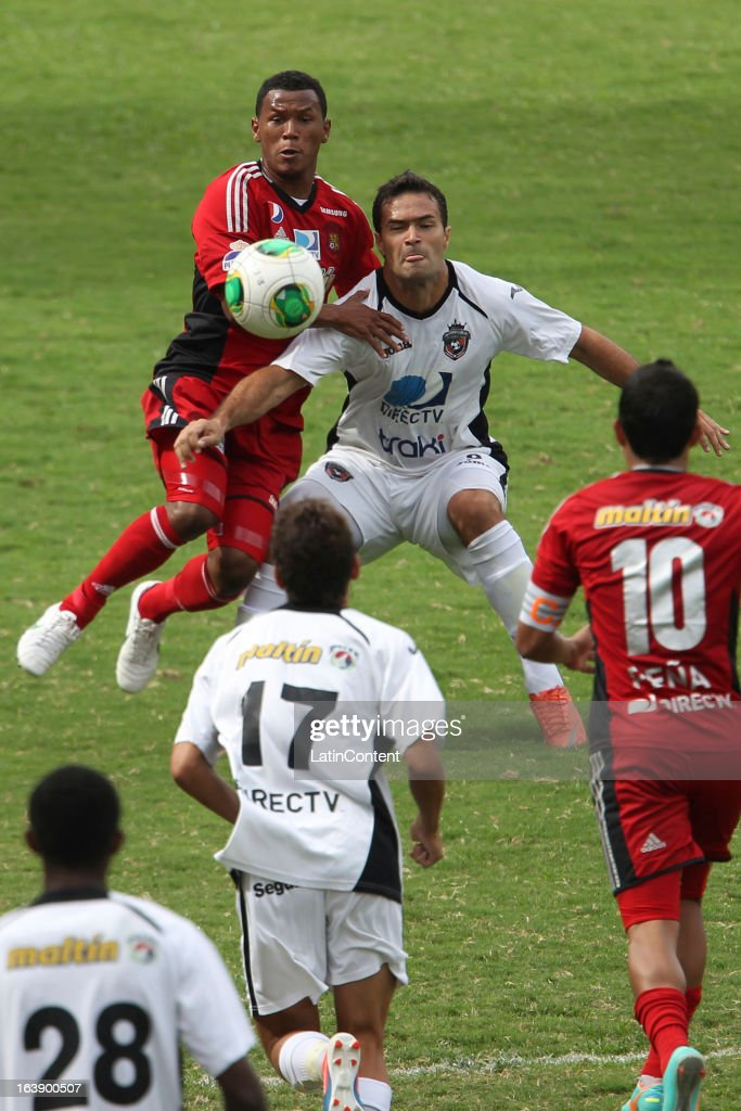 Javier Guarino of Real Esspor fights for the ball during the match between Real Esppor Club and Caracas FC at Brigido Iriarte Stadium on March 17, 2013 in Caracas, Venezuela.