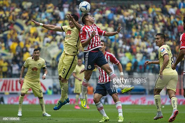 Javier Guemez of America jumps for the ball with Jose Ramirez of Chivas during a 10th round match between America and Chivas as part of the Apertura...
